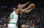 Boston Celtics center Al Horford (42) tries to block Brooklyn Nets forward Joe Harris (12) during the first quarter of an NBA basketball game in Boston, Monday, Jan. 28, 2019. (AP Photo/Charles Krupa)