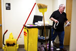 In this April 17, 2019, photo, Larry Elmore works part time as a janitor at Upper Cumberland Human Resource Agency in Cookeville, Tenn. Elmore first began taking opioids for legitimate pain from working in the mines. He did not know it was addictive at first until he was using the pills for everything. (Courtney Pedroza/The Tennessean via AP)