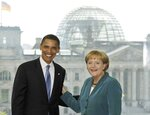 FILE - In this July 24, 2008 file photo, U.S. Democratic presidential candidate Sen. Barack Obama, D-Ill., left, is welcomed by German Chancellor Angela Merkel in the chancellery in Berlin, Germany. Angela Merkel has just about seen it all when it comes to U.S. presidents. Merkel on Thursday makes her first visit to the White House since Joe Biden took office. He is the fourth American president of her nearly 16-year tenure as German chancellor.  (AP Photo/Herbert Knosowski, File)