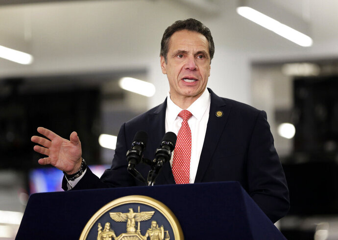 FILE - In this Feb. 14, 2019, file photo, New York Gov. Andrew Cuomo speaks before signing a bill in New York. Cuomo is being criticized for using a racial slur for African Americans while discussing historical discrimination toward dark-skinned Italian immigrants. He was in an interview Tuesday, Oct. 15, on WAMC radio while speaking about Columbus Day and a recent New York Times article about how Italians overcame bigotry in the U.S. Oct. 15. (AP Photo/Seth Wenig, File)