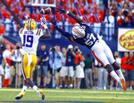 LSU wide receiver Derrick Dillon (19) catches a pass over the outstretched arms of Auburn linebacker Deshaun Davis (57) and runs in for a touchdown during the second half of an NCAA college football game, Saturday, Sept. 15, 2018, in Auburn, Ala. (AP Photo/Butch Dill)