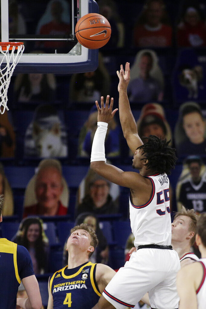 Gonzaga guard Dominick Harris (55) shoots next to Northern Arizona guard Carter Mahaney (4) during the second half of an NCAA college basketball game in Spokane, Wash., Monday, Dec. 28, 2020. Gonzaga won 88-58. (AP Photo/Young Kwak)