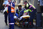 An injured woman is taken by ambulance from Hotel CBD at the corner of King and York Street in Sydney, Australia Tuesday, Aug. 13, 2019. Police and witnesses say a young man yelling about religion and armed with a knife has attempted to stab several people in downtown Sydney before being arrested, with one woman taken to a hospital. (Dean Lewins/AAP Image via AP)