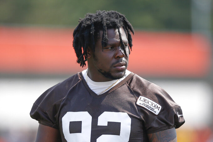 FILE - In this Aug. 14, 2018, file photo, Cleveland Browns defensive end Chad Thomas walks out to the field during NFL football training camp in Berea, Ohio. Browns defensive end Chad Thomas sustained a neck injury in practice Monday, Aug. 12, 2019, and is undergoing further tests at a hospital.(AP Photo/Ron Schwane, File)