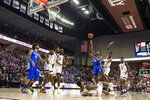Kentucky guard Immanuel Quickley (5) shoots over fallen Texas A&M guard Wendell Mitchell (11) during the first half of an NCAA college basketball game Tuesday, Feb. 25, 2020, in College Station, Texas. (AP Photo/Sam Craft)