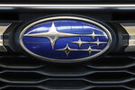 FILE - In this Feb. 14, 2019, file photo the Subaru logo on the front grill of a 2019 Subaru Impreza sedan is displayed at the 2019 Pittsburgh International Auto Show in Pittsburgh. Subaru is recalling over 400,000 vehicles in the U.S. to fix problems with engine computers and debris that can fall into motors. The first recall covers 466,000 Imprezas from 2017 through 2019, and 2018 and 2019 Crosstreks. (AP Photo/Gene J. Puskar, File)