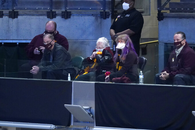 Sister Jean Dolores Schmidt, center, watches during the second half of a Sweet 16 game between Loyola Chicago and Oregon State in the NCAA men's college basketball tournament at Bankers Life Fieldhouse, Saturday, March 27, 2021, in Indianapolis. (AP Photo/Darron Cummings)