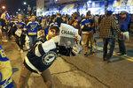 St. Louis Blues fans celebrate in the streets in front of the Enterprise Center in St. Louis after the St. Louis Blues defeated the Boston Bruins 4-1 in Game 7 of the Stanley Cup Final in Boston, Wednesday, June 12, 2019. (AP Photo/Scott Kane)