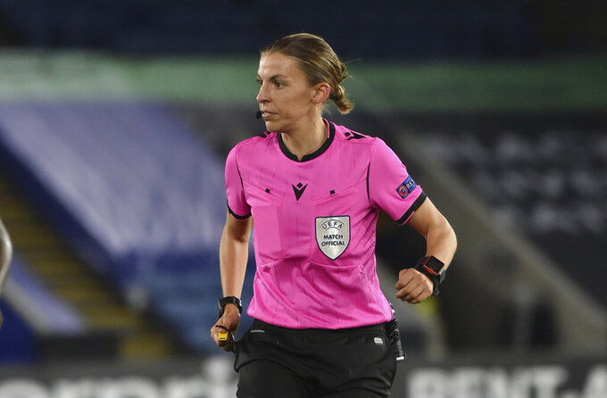French referee Stephanie Frappart officiates during the Europa League Group G soccer match between Leicester City and Zorya Luhansk at the King Power Stadium in Leicester, England, Thursday, Oct. 22, 2020. (AP Photo/Rui Vieira)
