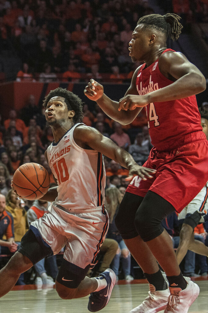 Illinois' Andres Feliz (10) powers past Nebraska's Yvan Ouedraogo (24) in the first half of an NCAA college basketball game Monday, Feb. 24, 2020, in Champaign, Ill. (AP Photo/Holly Hart)