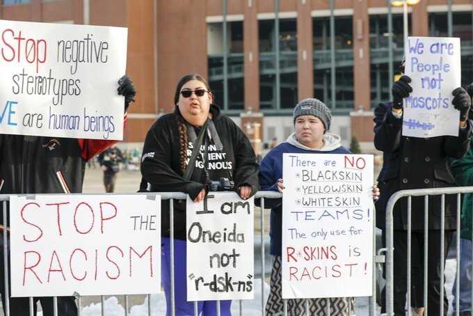 People protest the Washington Redskins name outside Lambeau Field before an NFL football game between the Green Bay Packers and the Washington Redskins Sunday, Dec. 8, 2019, in Green Bay, Wis. (AP Photo/Mike Roemer)