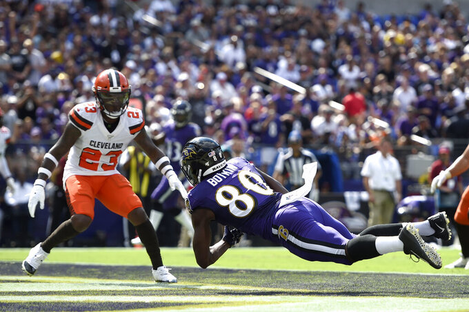 Baltimore Ravens wide receiver Miles Boykin (80) makes a touchdown catch on a pass from quarterback Lamar Jackson as Cleveland Browns strong safety Damarious Randall (23) looks on during the first half of an NFL football game Sunday, Sept. 29, 2019, in Baltimore. (AP Photo/Gail Burton)