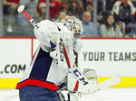 Washington Capitals' Braden Holtby deflects the puck with his board during the second period of an NHL hockey game against the Philadelphia Flyers, Wednesday, March 6, 2019, in Philadelphia. The Capitals won 5-3. (AP Photo/Tom Mihalek)
