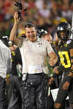 Oregon head coach Mario Cristobal celebrates after their win against Wisconsin in the Rose Bowl NCAA college football game Wednesday, Jan. 1, 2020, in Pasadena, Calif. (AP Photo/Mark J. Terrill)