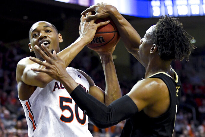 Auburn center Austin Wiley (50) and Vanderbilt guard Saben Lee (0) go for a rebound during the second half of an NCAA college basketball game Wednesday, Jan. 8, 2020, in Auburn, Ala. (AP Photo/Julie Bennett)