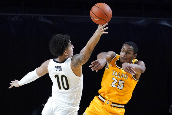 Valparaiso guard Nick Robinson (25) passes the ball past Vanderbilt forward Myles Stute (10) in the first half of an NCAA college basketball game Friday, Nov. 27, 2020, in Nashville, Tenn. (AP Photo/Mark Humphrey)