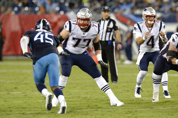New England Patriots offensive tackle Cedrick Lang (77) watches Tennessee Titans linebacker LaTroy Lewis (45) in the second half of a preseason NFL football game Saturday, Aug. 17, 2019, in Nashville, Tenn. (AP Photo/Mark Zaleski)
