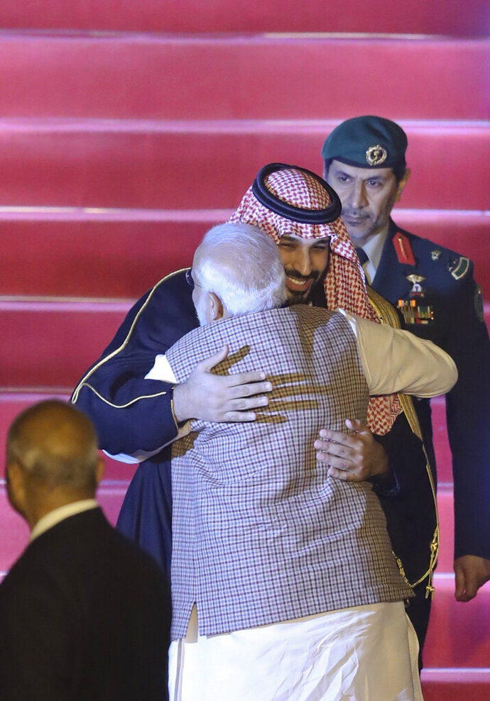 Saudi Arabia's Crown Prince Mohammed bin Salman is hugged by Indian Prime Minister Narendra Modi, back to camera, as he receives him at the airport in New Delhi, India, Tuesday, Feb.19, 2019. Prince Mohammed arrived in India after visiting Pakistan, which New Delhi blames for a suicide bombing attack last week that killed at least 40 Indian soldiers in disputed Kashmir. (AP Photo/Manish Swarup)