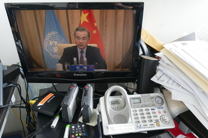 Chinese Foreign Minister Wang Yi is seen on a computer monitor at United Nations headquarters as he speaks during a virtual high-level meeting of the United Nations Security Council meeting on safeguarding international peace and security and global governance in the post-COVID-19 era happening during the 75th session of the United Nations General Assembly, Thursday, Sept. 24, 2020. (AP Photo/Mary Altaffer)