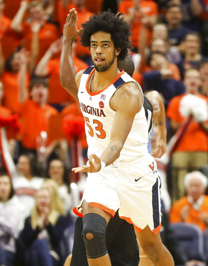 Virginia guard Tomas Woldetensae (53) celebrates a 3-point basket during an NCAA college basketball game against Columbia in Charlottesville, Va., Saturday, Nov. 16, 2019. (AP Photo/Andrew Shurtleff)
