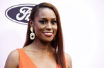 """FILE - This Feb. 6, 2020 file photo shows actress/writer/producer Issa Rae at the 13th Annual ESSENCE Black Women in Hollywood Awards Luncheon in Beverly Hills, Calif. Rae is looking to find up-and-coming fashion, film, music and visual art creatives from underrepresented communities. She's teaming up with LIFEWTR, PepsiCo's bottled water product line and its """"Life Unseen"""" campaign.  (AP Photo/Chris Pizzello, File)"""