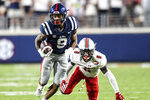 Mississippi running back Jerrion Ealy (9) runs past Austin Peay safety Kory Chapman (6) during an NCAA college football game in Oxford, Miss., Saturday, Sept. 11, 2021. (AP Photo/Bruce Newman)