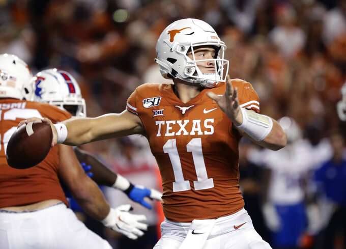 FILE - In this Aug. 31, 2019, file photo, Texas quarterback Sam Ehlinger (11) throws against Louisiana Tech during the second half of an NCAA college football game in Austin, Texas. For Texas, everything starts with Ehlinger, a dual-threat quarterback who is drawing comparisons to former Florida Heisman Trophy winner Tim Tebow. (AP Photo/Eric Gay, File)