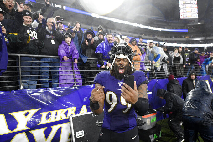 Baltimore Ravens outside linebacker Matt Judon (99) reacts while holding a smartphone after an NFL football game against the Pittsburgh Steelers, Sunday, Dec. 29, 2019, in Baltimore. The Ravens won 28-10. (AP Photo/Nick Wass)
