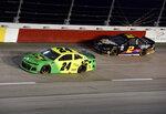 William Byron (24) races ahead of Brad Keselowski (2) during a NASCAR Cup Series auto race on Sunday, Sept. 1, 2019, at Darlington Raceway in Darlington, S.C. (AP Photo/Richard Shiro)