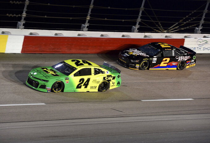 William Byron (24) races ahead of Brad Keselowski (2) during a NASCAR Cup Series auto race on Sunday, Sept. 1, 2019, at Darlington Raceway in Darlington, S.C. (AP Photo/Richard Shiro)