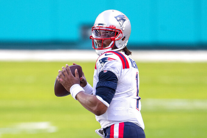"FILE - New England Patriots quarterback Cam Newton (1) looks to throw the ball against the Miami Dolphins during an NFL football game in Miami Gardens, Fla., in this Sunday, Dec. 20, 2020, file photo. Washington's biggest offseason need is to figure out its quarterback situation. Trade for DeShaun Watson? Sign Cam Newton? Roll with Alex Smith and Kyle Allen? Coach Ron Rivera says ""nothing is off the table."" (AP Photo/Doug Murray, File)"