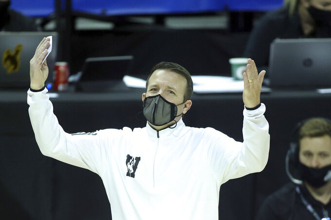 Wyoming head coach Jeff Linder reacts to a call during the second half of an NCAA college basketball game against San Jose State in the first round of the Mountain West Conference men's tournament Wednesday, March 10, 2021, in Las Vegas. (AP Photo/Isaac Brekken)