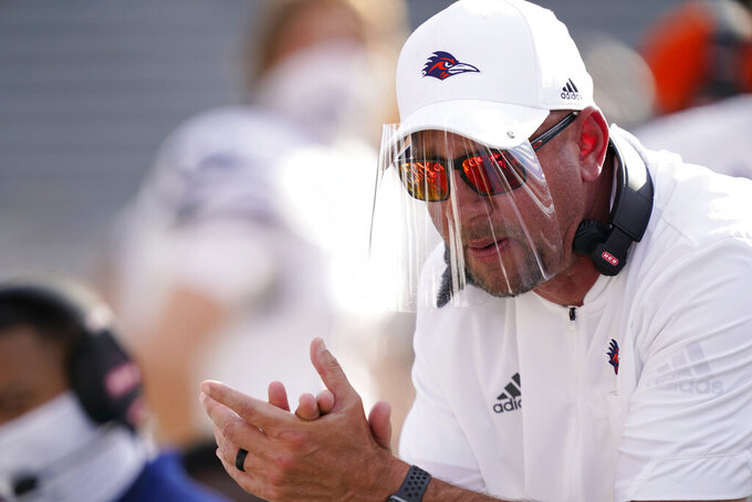 UTSA head coach Jeff Traylor urges his team during the first half of an NCAA college football game against Southern Mississippi, Saturday, Nov. 21, 2020, in Hattiesburg, Miss. (AP Photo/Rogelio V. Solis)
