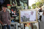 Cutout and portraits of Indonesian President Joko Widodo are displayed at a stall that sells portraits of Indonesian leaders, in Jakarta, Indonesia, Friday, Sept. 20, 2019. Widodo has asked lawmakers to delay a vote on a proposed new criminal code amid critics saying that the bill contains articles that may discriminate against minorities and violate freedom of speech.(AP Photo/Tatan Syuflana)