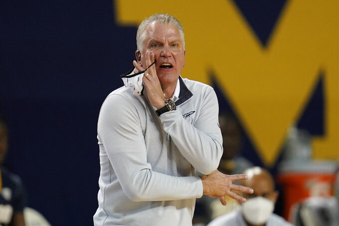 Toledo head coach Tod Kowalczyk signals a play in the second half of an NCAA college basketball game against Michigan in Ann Arbor, Mich., Wednesday, Dec. 9, 2020. (AP Photo/Paul Sancya)