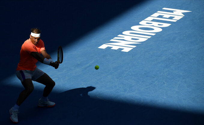 Spain's Rafael Nadal hits a backhand return to Italy's Fabio Fognini during their fourth round match at the Australian Open tennis championship in Melbourne, Australia, Monday, Feb. 15, 2021.(AP Photo/Andy Brownbill)