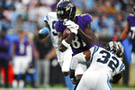 Carolina Panthers wide receiver Krishawn Hogan is tackled by Carolina Panthers' Josh Bynes during the first half of a preseason NFL football game Saturday, Aug. 21, 2021, in Charlotte, N.C. (AP Photo/Jacob Kupferman)