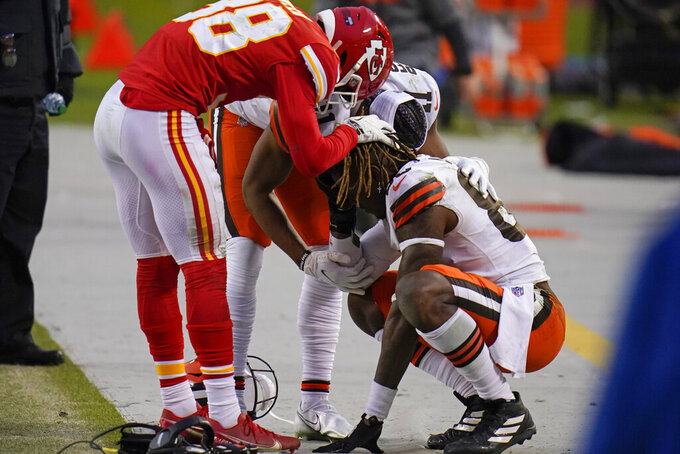 Kansas City Chiefs safety L'Jarius Sneed, left, consoles Cleveland Browns tight end David Njoku, right, after an NFL divisional round football game, Sunday, Jan. 17, 2021, in Kansas City. The Chiefs won 22-17. (AP Photo/Jeff Roberson)