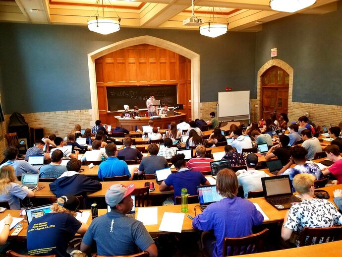 This photo provided by the University of Michigan shows students participating in the 2018 University of Michigan Debate Camp, at the University of Michigan Law School in Ann Arbor, Mich. Dozens of policy debate camps nationwide offer a win-win opportunity for teens and colleges, organizers and participants say. For thousands of teens across the country, summer camp is about policy debate, and the joy of doing research and making well-argued points of varying perspectives in a college setting. (Brian Rubaie/University of Michigan via AP)