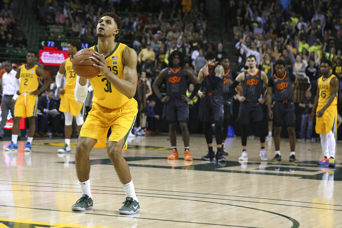 Baylor guard MaCio Teague shoots a pair of free throws after a technical foul against Oklahoma State during the second half of an NCAA college basketball game Saturday, Feb. 8, 2020, in Waco, Texas. (AP Photo/Rod Aydelotte)