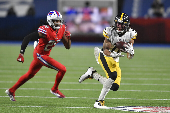 Pittsburgh Steelers wide receiver Chase Claypool (11) catches a pass with Buffalo Bills cornerback Josh Norman (29) defending during the first half of an NFL football game in Orchard Park, N.Y., Sunday, Dec. 13, 2020. (AP Photo/Adrian Kraus)