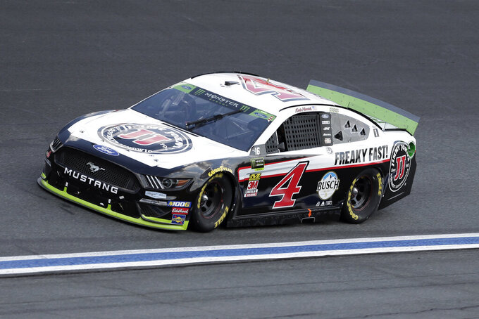 Kevin Harvick drives through Turn 4 during the NASCAR Cup Series auto race at Charlotte Motor Speedway in Concord, N.C., Sunday, Sept. 29, 2019. (AP Photo/Gerry Broome)