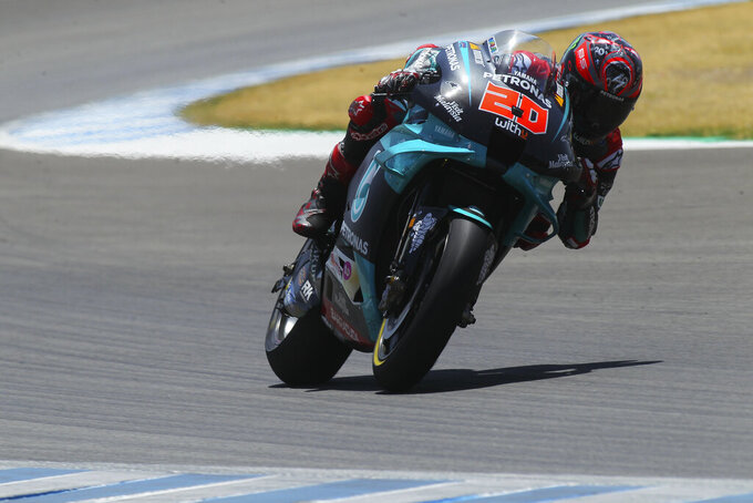 Yamaha rider Fabio Quartararo of France rides on his way to winning the MotoGP race during the Andalucia Motorcycle Grand Prix at the Angel Nieto racetrack in Jerez de la Frontera, Spain, Sunday July 26, 2020. (AP Photo/David Clares)