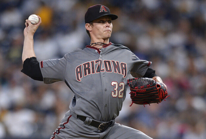 FILE - In this Aug. 16, 2018, file photo, Arizona Diamondbacks starting pitcher Clay Buchholz works against the San Diego Padres during the first inning of a baseball game in San Diego. Buchholz and the Toronto Blue Jays have finalized a $3 million, one-year contract, the team announced Tuesday, March 5, 2019. The 34-year-old right-hander is expected to join a starting rotation that includes Marcus Stroman and Aaron Sanchez. (AP Photo/Orlando Ramirez, File)