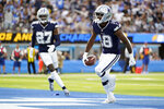 Dallas Cowboys strong safety Damontae Kazee, right, celebrates after intercepting a pass during the second half of an NFL football game against the Los Angeles Chargers Sunday, Sept. 19, 2021, in Inglewood, Calif. (AP Photo/Ashley Landis)
