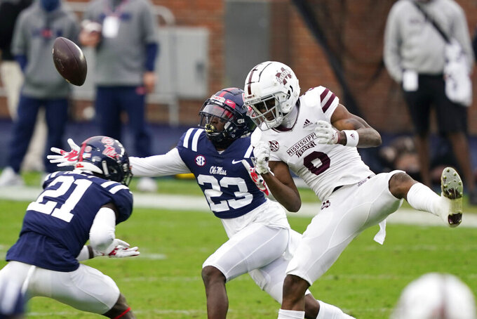 Mississippi defensive backs Jakorey Hawkins (23) and A.J. Finley (21) try to intercept a pass intended for Mississippi State wide receiver JaVonta Payton (0) during the first half of an NCAA college football game, Saturday, Nov. 28, 2020, in Oxford, Miss. (AP Photo/Rogelio V. Solis)