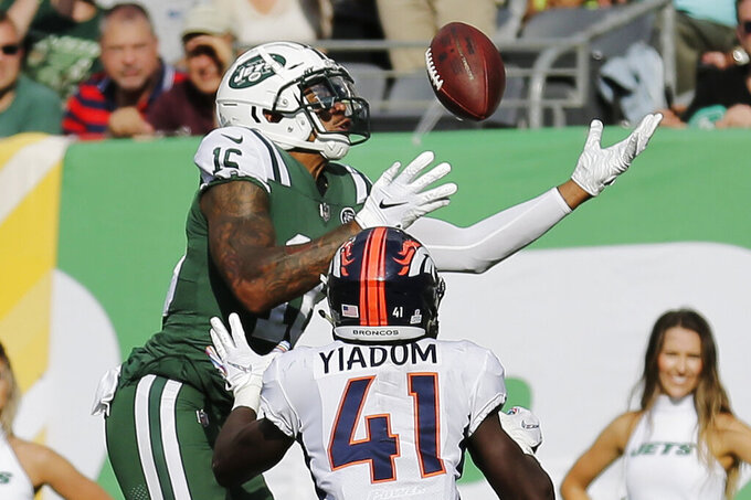 FILE - In this Oct. 7, 2018, file photo, New York Jets' Terrelle Pryor (16) leaps over Denver Broncos' Isaac Yiadom (41) to catch a pass for a touchdown during the second half of an NFL football game in East Rutherford, N.J. The Jacksonville Jaguars have signed journeyman receiver Terrelle Pryor, giving the team more depth and experience at the position. Pryor signed a one-year deal Monday, June 3, 2019, and was expected to practice during organized team activities.(AP Photo/Seth Wenig, File)