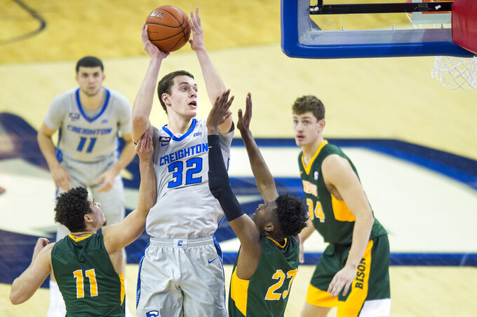 Creighton's Ryan Kalkbrenner (32) scores against North Dakota State's Jarius Cook, left, and Maleeck Harden-Hayes during the second half of an NCAA college basketball game in Omaha, Neb., Sunday, Nov. 29, 2020. (AP Photo/Kayla Wolf)