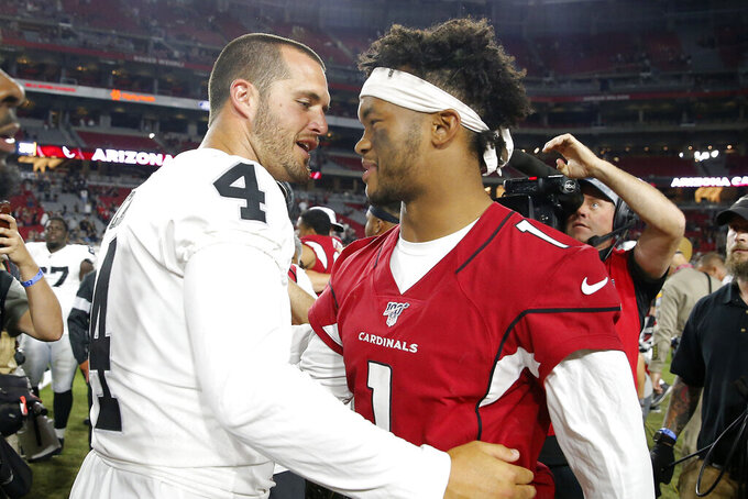 Arizona Cardinals punter Andy Lee (4) and Arizona Cardinals quarterback Kyler Murray (1) meet at midfield after an an NFL preseason football game, Thursday, Aug. 15, 2019, in Glendale, Ariz. The Raiders won 33-26. (AP Photo/Rick Scuteri)