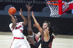 Rutgers' Montez Mathis, left,  scores over, second from left to right, Nebraska's Eduardo Andre, Trevor Lakes, and Dalano Banton in the first half of an NCAA college basketball game Monday, March 1, 2021, in Lincoln, Neb. (Kenneth Ferriera/Lincoln Journal Star via AP)
